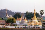 Founded in 1827 by Phaya Singhanataraj, the Shan ruler of Mae Hong Son, Wat Chong Kham contains a 5 metre Buddha image known as Luang Pho To.<br/><br/>  Wat Chong Klang, built in the 1860s, is a Shan Burmese temple overlooking Chong Kham Lake. The temple contains almost 200 glass paintings illustrating individual episodes in the Buddhist jataka tales (stories from the lives of the various Buddhas).<br/><br/>  Once one of Thailand's remotest provinces, Mae Hong Son is now readily accessible by air from Chiang Mai, as well as by a wonderful loop drive through Mae Sariang and back via Pai and Soppong– or vice versa. Singularly isolated, Mae Hong Son is not yet very developed. The townsfolk may be citizens of Thailand, but most are Shan, Karen, Yunnanese Chinese or Hill Tribes. The temples are Burmese in style, and the pace of life amazingly tranquil.